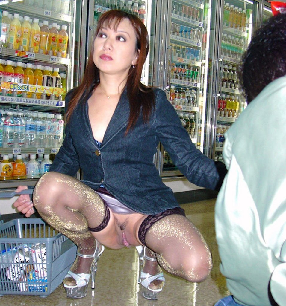 Hot Asian Milf flashing her pussy in store