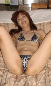 Sexy skinny amateur Asian milf with tiny tits wearing animal print panties