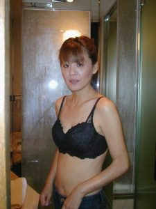 Older Asian wife caught without her shirt just a sexy black bra