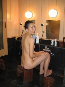 Asian Milf in a traditional Japanese bath very cute body