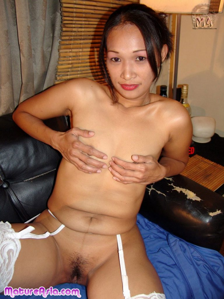 Cute Asian grandma showing her old pussy and covering her tiny tits