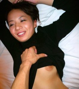 Cute sexy Asian Milf with great smile showing a nipple