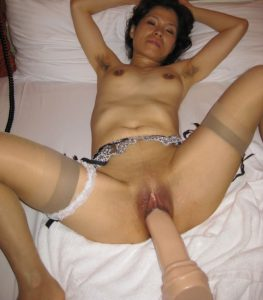 mature Asian wife taking a huge dildo in her pussy