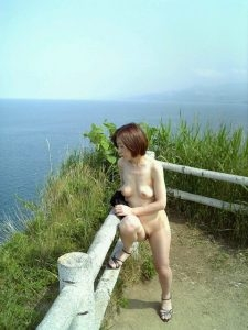 Asian granny hiking nude showing her old bald pussy and mature tits