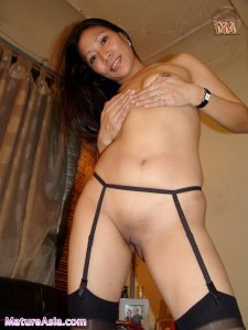 Amateur Filipino granny Janna showing her shaved pussy wearing garter and stockings