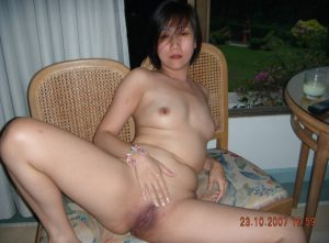 Petite Asian mom siting with tiny tits and bald shaved pussy