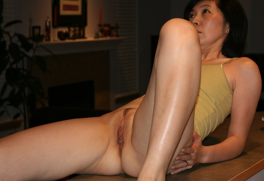 Beautiful Asian mom with a clean shaved bald pussy very sexy