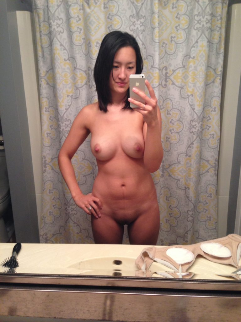 Very cute and sexy Asian mom naked showing her body taking a selfie