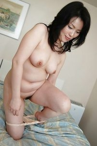Chubby mature Asian Milf taking off panties she is cute