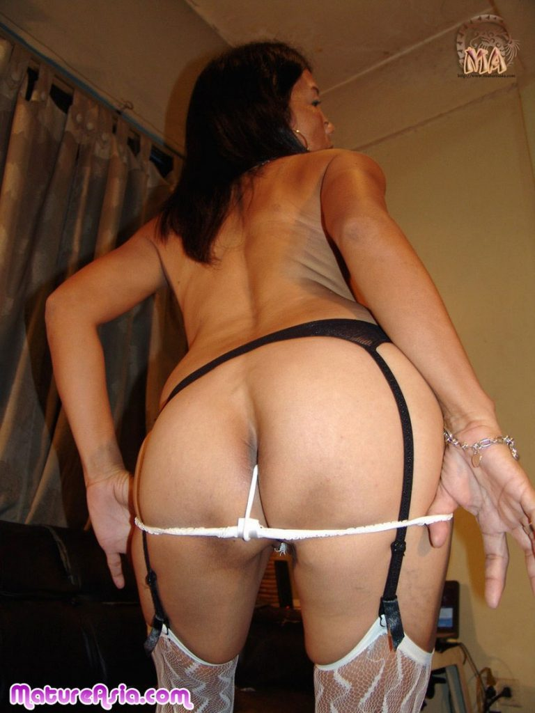 Petite Asian grandma pulling panties down showing her ass
