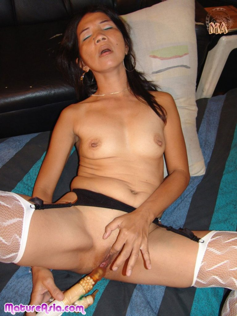 Petite and tiny Asian granny using a dildo on her wet pussy