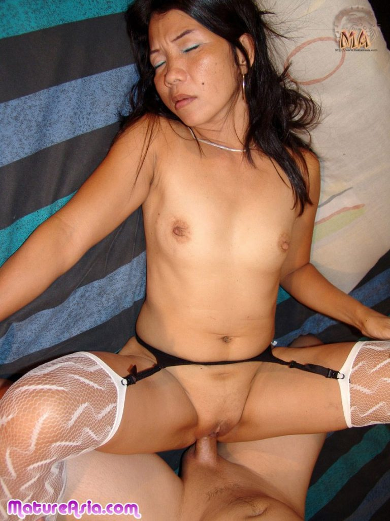 Tiny Asian grandma in stockings having sex she is very petite
