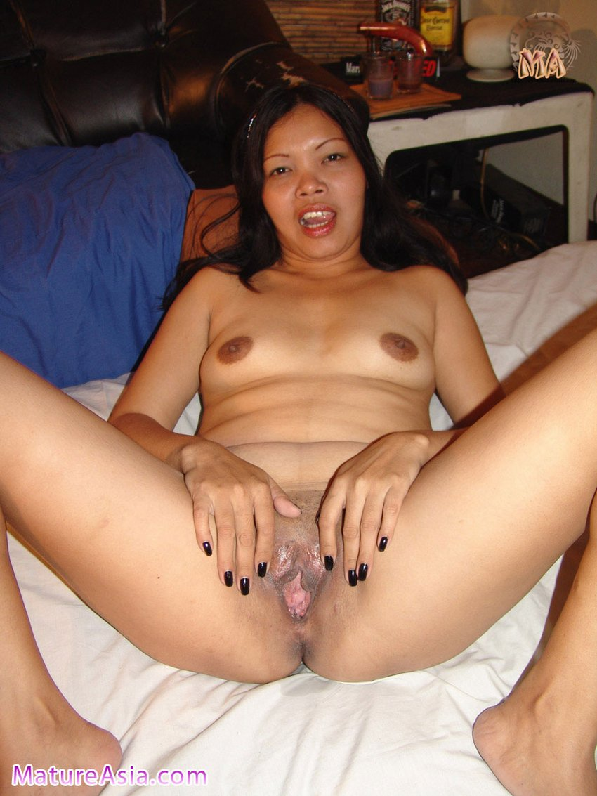 Mature Asian grandma Tricia legs open spreading pussy