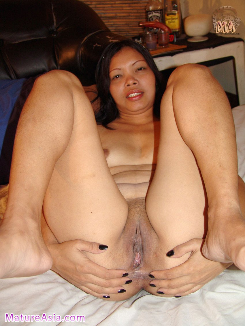 Mature Asian grandma Tricia spreading her asshole ready for use