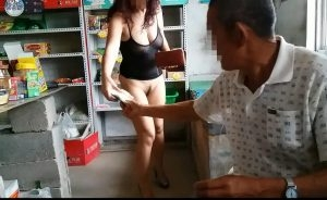 Naked amateur Asian granny attempting to shock a store owner