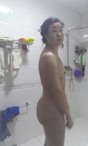 Chinese wife with tiny tits about to wash pussy before sex
