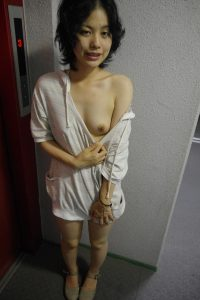 Hot sultry Asian wife gives us a flash of her sexy tiny tit