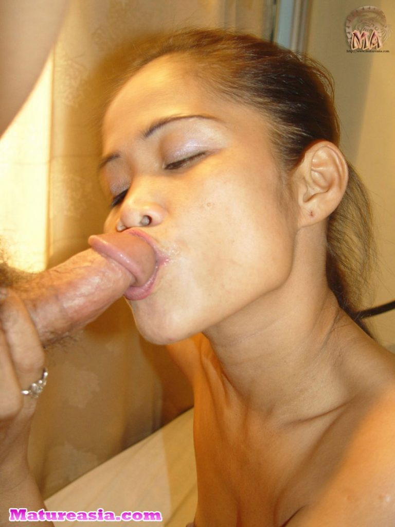 Hot Asian mom with a dick in her mouth