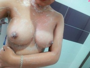 Amateur Asian Indo showing soaping up  ample tits