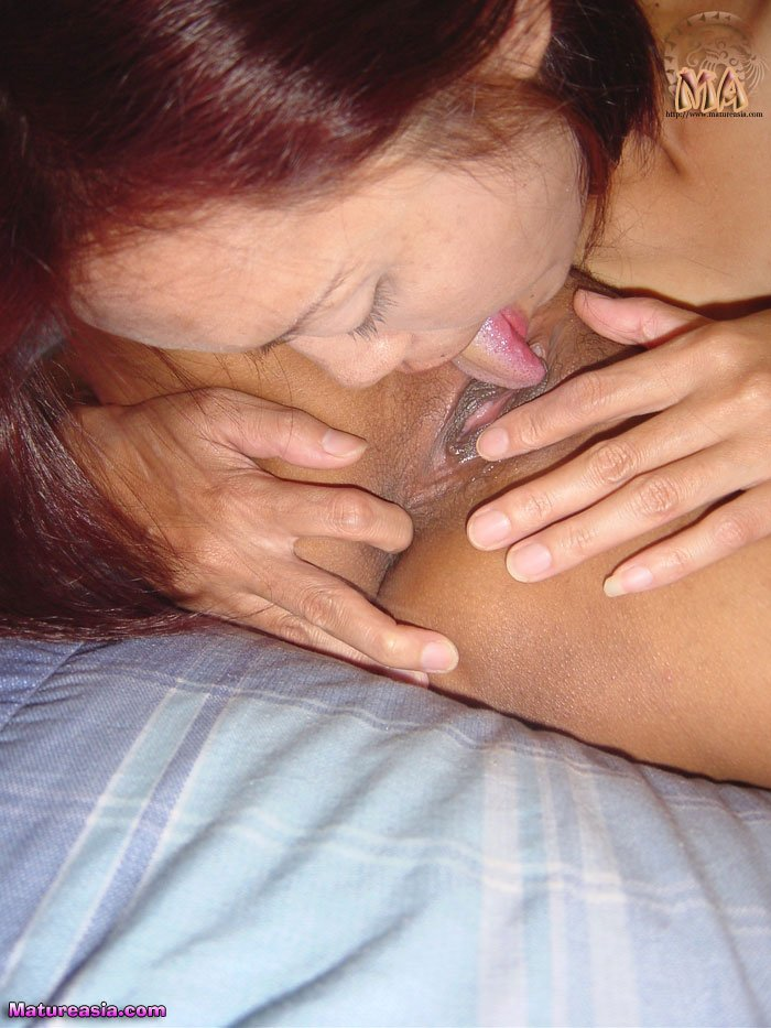 Older mature Asian lesbians licking and playing with each other pussies